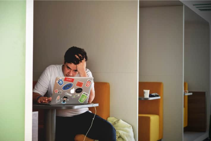 Frustrated man on a laptop browsing